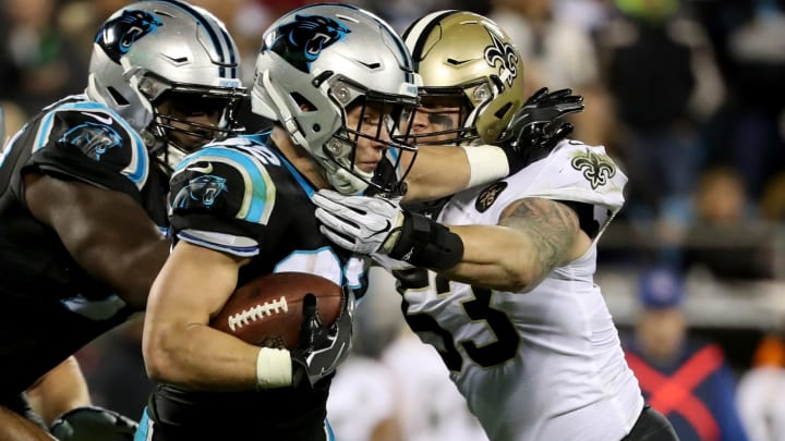 CHARLOTTE, NC – DECEMBER 17: Christian McCaffrey #22 of the Carolina Panthers runs the ball against A.J. Klein #53 of the New Orleans Saints in the second quarter during their game at Bank of America Stadium on December 17, 2018 in Charlotte, North Carolina. (Photo by Streeter Lecka/Getty Images)