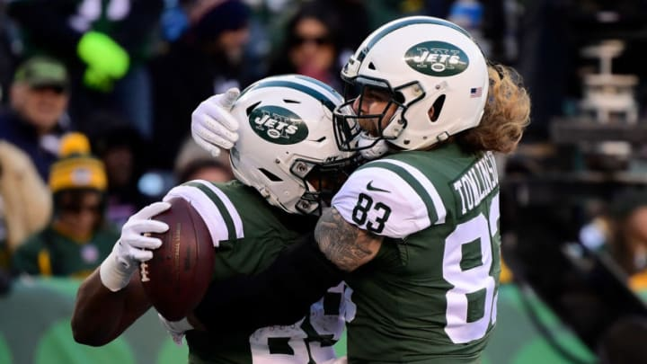 EAST RUTHERFORD, NJ - DECEMBER 23: Chris Herndon #89 of the New York Jets celebrates with Eric Tomlinson #83 after socring a touchdown against the Green Bay Packers during the third quarter at MetLife Stadium on December 23, 2018 in East Rutherford, New Jersey. (Photo by Steven Ryan/Getty Images)