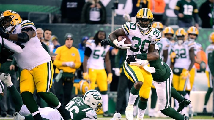 EAST RUTHERFORD, NJ – DECEMBER 23: Jamaal Williams #30 of the Green Bay Packers makes a run for a first down against the New York Jets during the third quarter at MetLife Stadium on December 23, 2018 in East Rutherford, New Jersey. (Photo by Steven Ryan/Getty Images)