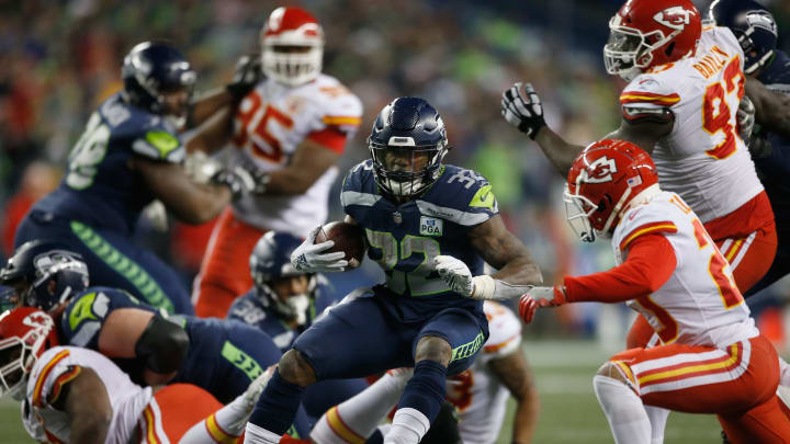 SEATTLE, WA – DECEMBER 23: Chris Carson #32 of the Seattle Seahawks carries the ball against the Kansas City Chiefs during the fourth quarter of the game at CenturyLink Field on December 23, 2018 in Seattle, Washington. (Photo by Otto Greule Jr/Getty Images)