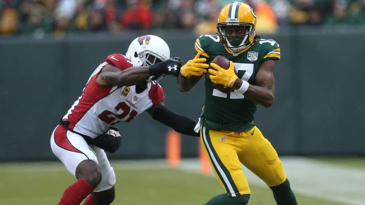 GREEN BAY, WISCONSIN – DECEMBER 02: Davante Adams #17 of the Green Bay Packers makes a catch in front of Patrick Peterson #21 of the Arizona Cardinals during the second half of a game at Lambeau Field on December 02, 2018 in Green Bay, Wisconsin. (Photo by Dylan Buell/Getty Images)