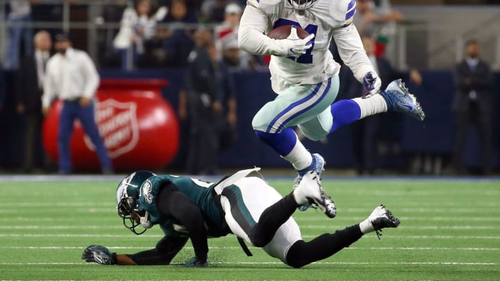 ARLINGTON, TEXAS – DECEMBER 09: Ezekiel Elliott #21 of the Dallas Cowboys leaps past Corey Graham #24 of the Philadelphia Eagles on a carry in the fourth quarter at AT&T Stadium on December 09, 2018 in Arlington, Texas. (Photo by Richard Rodriguez/Getty Images)