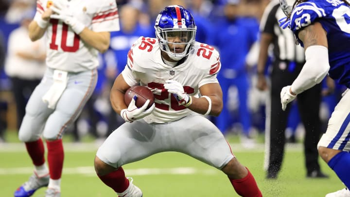 INDIANAPOLIS, INDIANA – DECEMBER 23: Saquon Barkley #26 of the New York Giants runs the ball in the game against the Indianapolis Colts in the third quarter at Lucas Oil Stadium on December 23, 2018 in Indianapolis, Indiana. (Photo by Andy Lyons/Getty Images)