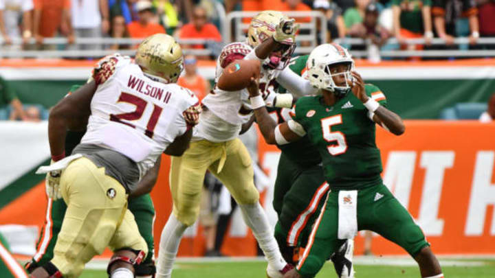 MIAMI, FL – OCTOBER 06: Brian Burns #99 of the Florida State Seminoles causes a fumble by N'Kosi Perry #5 of the Miami Hurricanes in the first half at Hard Rock Stadium on October 6, 2018 in Miami, Florida. New York Jets 2019 NFL Draft (Photo by Mark Brown/Getty Images)