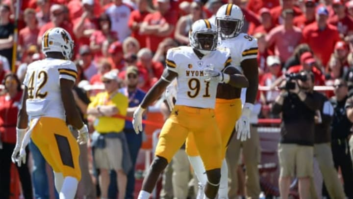 LINCOLN, NE – SEPTEMBER 10: Defensive end Carl Granderson #91 of the Wyoming Cowboys celebrates a stop against the Nebraska Cornhuskers at Memorial Stadium on September 10, 2016 in Lincoln, Nebraska. Nebraska defeated Wyoming 52-14. (Photo by Steven Branscombe/Getty Images)