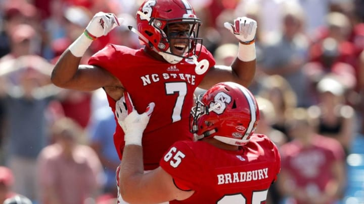 CHARLOTTE, NC - SEPTEMBER 02: Nyheim Hines #7 and teammate Garrett Bradbury #65 of the North Carolina State Wolfpack celebrate after Hines scores a touchdown against the South Carolina Gamecocks during their game at Bank of America Stadium on September 2, 2017 in Charlotte, North Carolina. (Photo by Streeter Lecka/Getty Images)