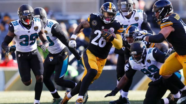 PITTSBURGH, PA - JANUARY 14: Le'Veon Bell #26 of the Pittsburgh Steelers runs with the ball against the Jacksonville Jaguars during the first half of the AFC Divisional Playoff game at Heinz Field on January 14, 2018 in Pittsburgh, Pennsylvania. (Photo by Kevin C. Cox/Getty Images)