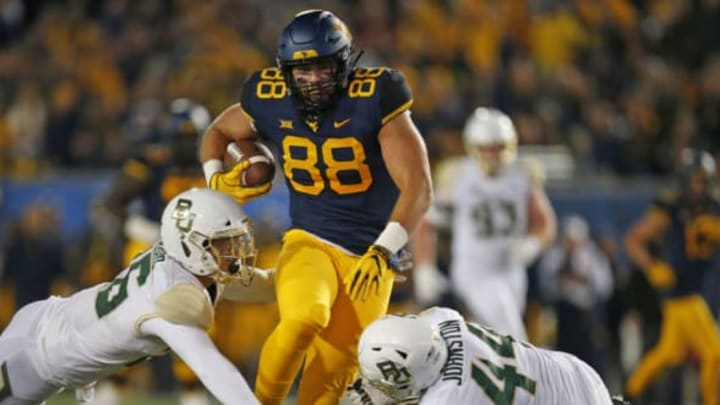 MORGANTOWN, WV – OCTOBER 25: Trevon Wesco #88 of the West Virginia Mountaineers runs after the catch against Terrel Bernard #26 and Clay Johnston #44 of the Baylor Bears at Mountaineer Field on October 25, 2018 in Morgantown, West Virginia. (Photo by Justin K. Aller/Getty Images)