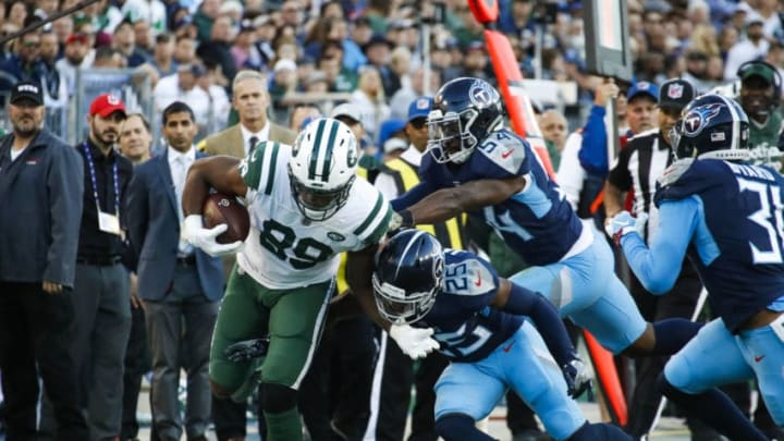 NASHVILLE, TN - DECEMBER 2: Chris Herndon #89 of the New York Jets runs with the ball against the Tennessee Titans during the second quarter at Nissan Stadium on December 2, 2018 in Nashville, Tennessee. (Photo by Frederick Breedon/Getty Images)