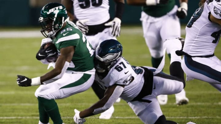 EAST RUTHERFORD, NJ - AUGUST 29: Aziz Shittu #67 of Philadelphia Eagles takes down Elijah McGuire #25 of the New York Jets during the preseason game at MetLife Stadium on August 29, 2019 in East Rutherford, New Jersey. (Photo by Jeff Zelevansky/Getty Images)