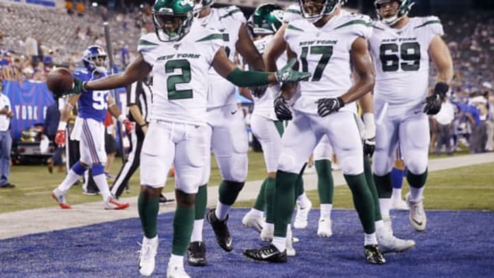 EAST RUTHERFORD, NEW JERSEY – AUGUST 08: Greg Dortch #2 of the New York Jets celebrates his touchdown with teammates Charone Peake #17 and Ben Braden #69 in the fourth quarter against the New York Giants during a preseason matchup at MetLife Stadium on August 08, 2019 in East Rutherford, New Jersey.New York Jets (Photo by Elsa/Getty Images)