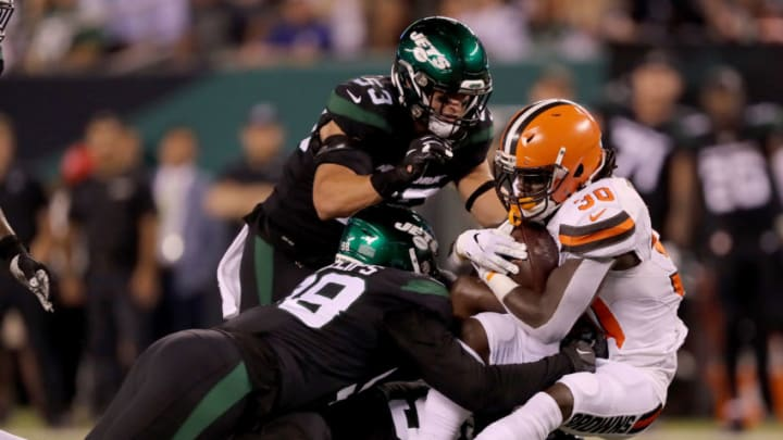 EAST RUTHERFORD, NEW JERSEY - SEPTEMBER 16: D'Ernest Johnson #30 of the Cleveland Browns is tackled by Kyle Phillips #98 and Blake Cashman #53 of the New York Jets in the second quarter at MetLife Stadium on September 16, 2019 in East Rutherford, New Jersey. (Photo by Elsa/Getty Images)