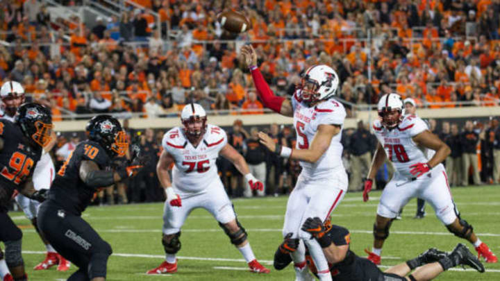 Nov 12, 2016; Stillwater, OK, USA; Texas Tech Red Raiders quarterback Patrick Mahomes II (5) throws the ball as Oklahoma State Cowboys defensive end Cole Walterscheid (82) attempts a sack during the second half at Boone Pickens Stadium. Cowboys won 45-44. Mandatory Credit: Rob Ferguson-USA TODAY Sports