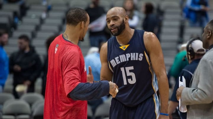 Jan 27, 2015; Dallas, TX, USA; Memphis Grizzlies guard Vince Carter (15) talks to former teammate Dallas Mavericks guard Monta Ellis (11) after the game at the American Airlines Center. The Grizzlies defeated the Mavericks 109-90. Mandatory Credit: Jerome Miron-USA TODAY Sports