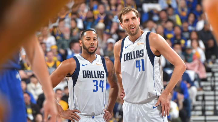 OAKLAND, CA – MARCH 23: Devin Harris #34 of the Dallas Mavericks and Dirk Nowitzki #41 of the Dallas Mavericks look on during a game against the Golden State Warriors on March 22, 2019 at ORACLE Arena in Oakland, California. NOTE TO USER: User expressly acknowledges and agrees that, by downloading and or using this photograph, user is consenting to the terms and conditions of Getty Images License Agreement. Mandatory Copyright Notice: Copyright 2019 NBAE (Photo by Jesse D. Garrabrant/NBAE via Getty Images)