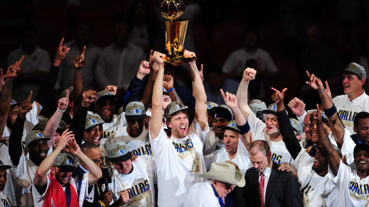Dirk Nowitzki (C) of the Dallas Mavericks celebrates with teammates after winning the NBA Finals against the Miami Heat on June 12, 2011 at the AmericanAirlines Arena in Miami, Florida. Jason Terry scored 27 points and Nowitzki finished with 21 points and 11 rebounds as the Mavericks won 105-95 to take the best-of-seven championship series four-games-to-two to claim their first NBA championship in franchise history. AFP PHOTO / Mark RALSTON (Photo credit should read MARK RALSTON/AFP/Getty Images)