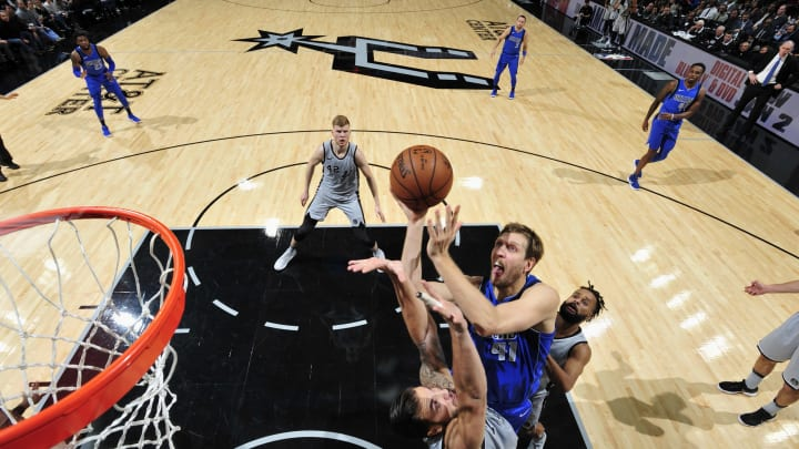 ANTONIO, TX – DECEMBER 16: Dirk Nowitzki #41 of the Dallas Mavericks goes to the basket against the San Antonio Spurs on December 16, 2017 at the AT&T Center in San Antonio, Texas. NOTE TO USER: User expressly acknowledges and agrees that, by downloading and or using this photograph, user is consenting to the terms and conditions of the Getty Images License Agreement. Mandatory Copyright Notice: Copyright 2017 NBAE (Photos by Mark Sobhani/NBAE via Getty Images)