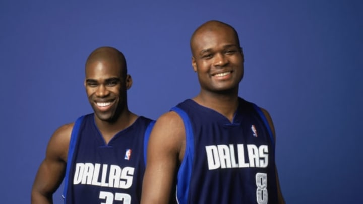 DALLAS – APRIL 22: Antawn Jamison #33 and Antoine Walker #8 of the Dallas Mavericks pose for a portrait on April 22, 2004 in Dallas, Texas. NOTE TO USER: User expressly acknowledges and agrees that, by downloading and/or using this Photograph, User is consenting to the terms and conditions of the Getty Images License Agreement. (Photo by Jennifer Pottheiser/NBAE via Getty Images)