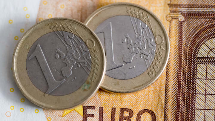 photo illustration: Euro banknotes with coins