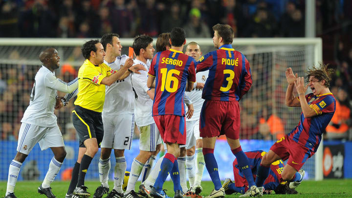 Barcelona's captain Carles Puyol (R) rea