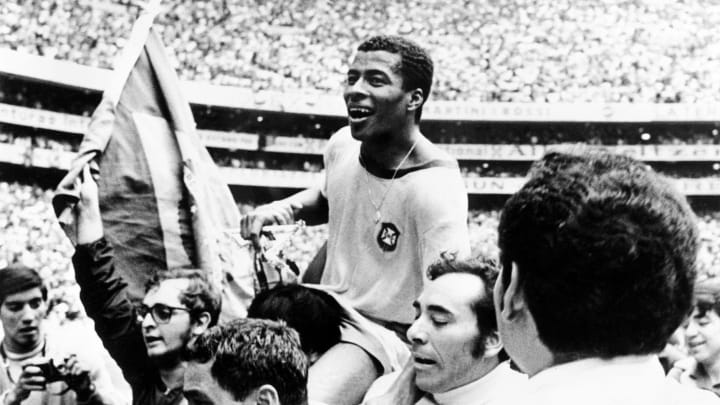Brazilian forward Jairzinho is carried by fans aft