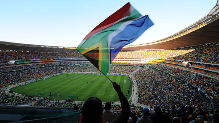 Football's fans cheer in Soccer City in