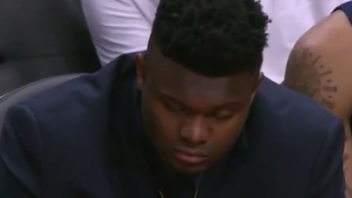 Zion Williamson falling asleep on the Pelicans bench.