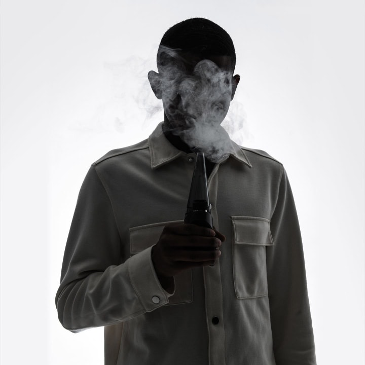 man holding Puffco Peak Pro