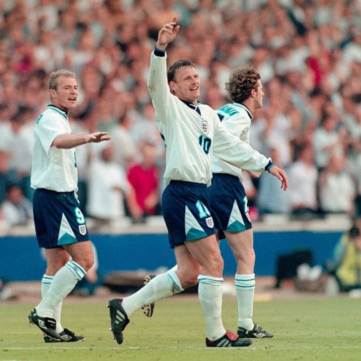 Teddy Sheringham celebrates one of his two strikes against the Netherlands