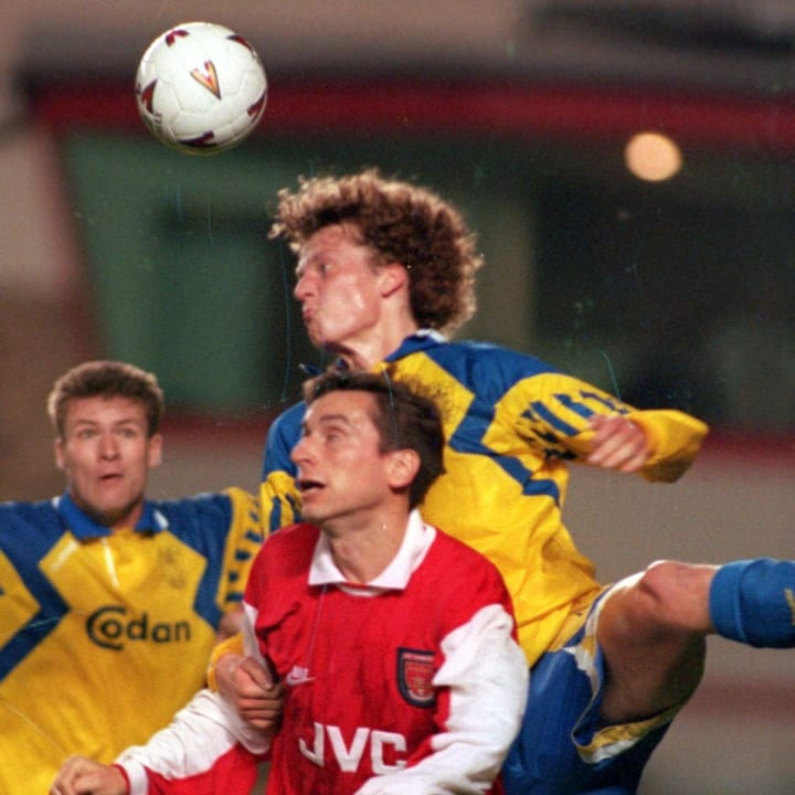 Alan Smith challenges for a header