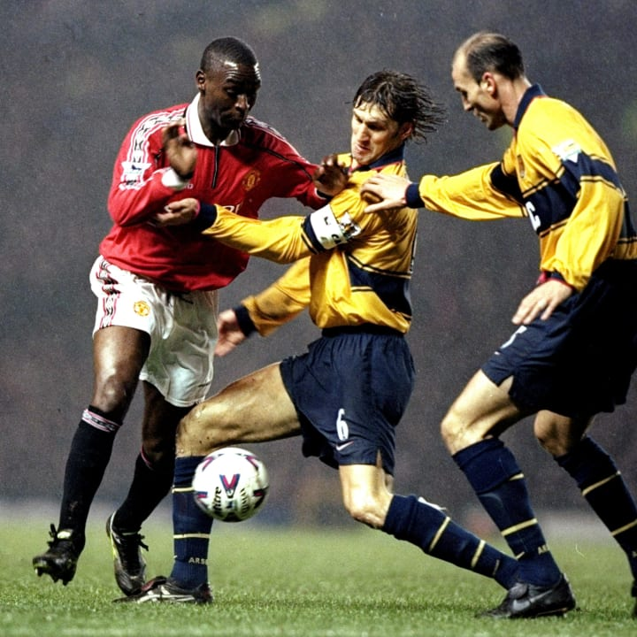 Andy Cole faces Tony Adams and Steve Bould