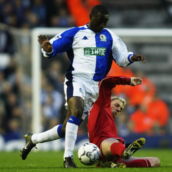Andy Cole challenge Liverpool's Stephane Henchoz