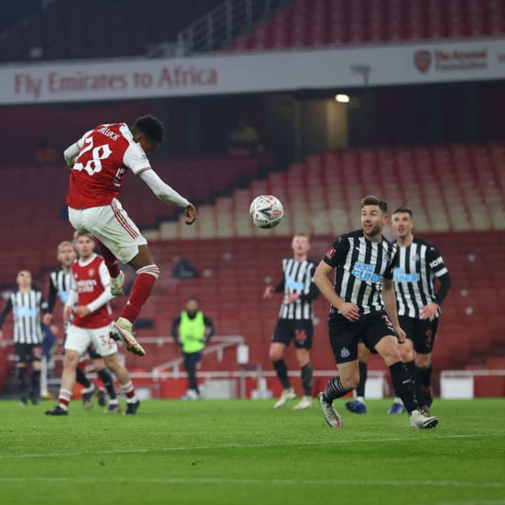Willock aims his header towards goal.