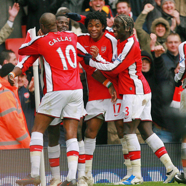 Arsenal's Emmanuel Eboue (2nd L) celebra
