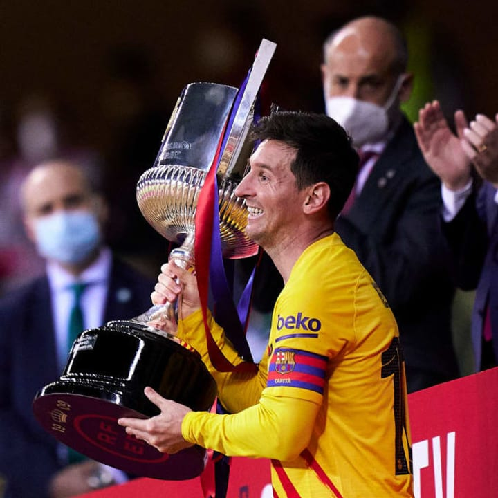 Lionel Messi holds the Copa del Rey trophy
