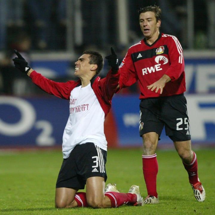 Bayer 04 Leverkusen's Lucio (L) and his