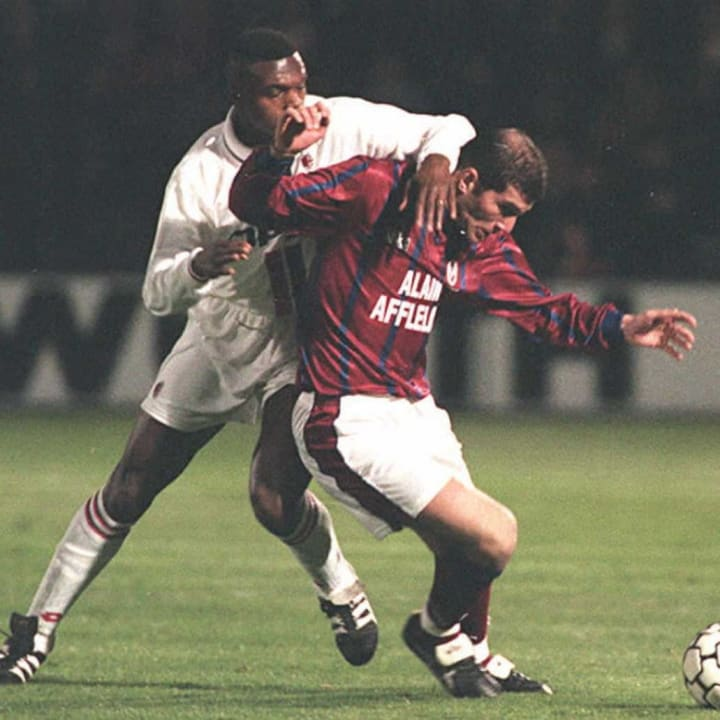 Bordeaux's Zinedine Zidane (R) struggles to keep M