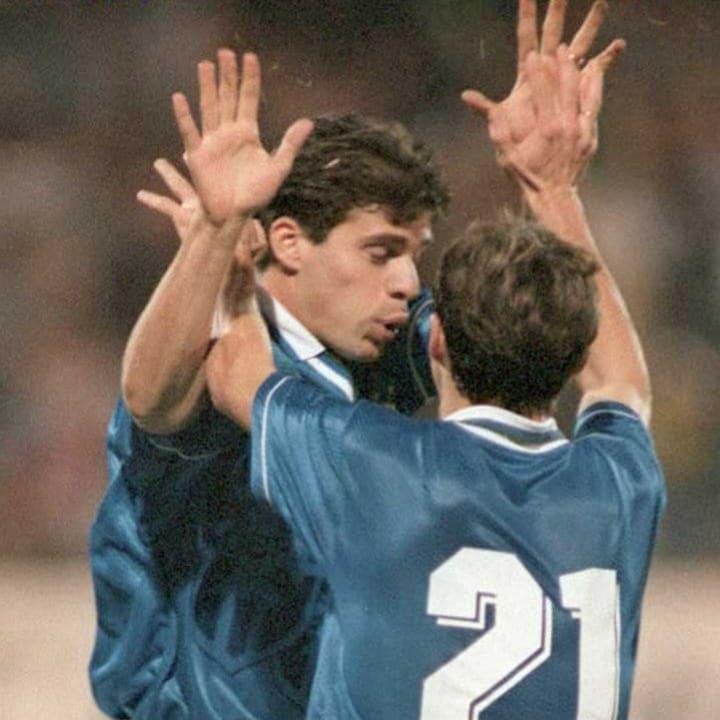 Brazilian Savio congratulates teammate Tulio (L) a