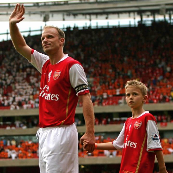 Dennis Bergkamp waves as he leads his so