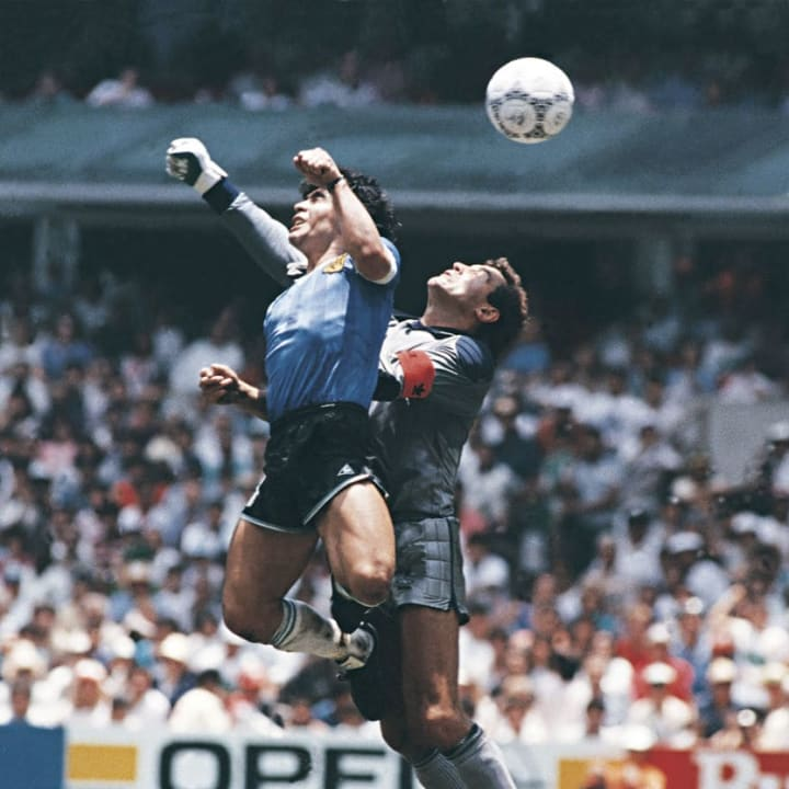Diego Maradona out-jumps Peter Shilton