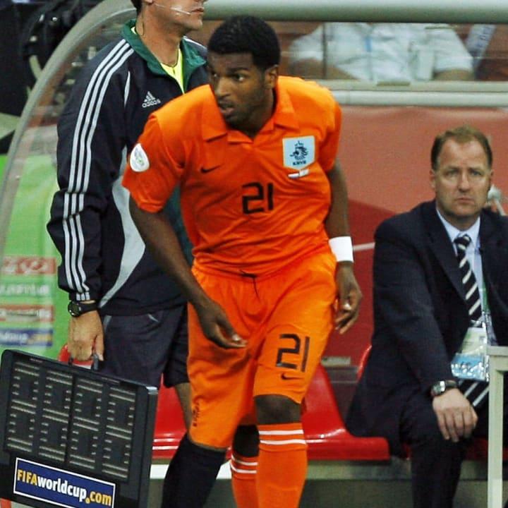 Dutch forward Ryan Babel (L) comes on as