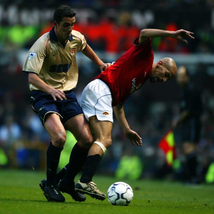 Edu of Arsenal and Juan Sebastian Veron of Manchester United