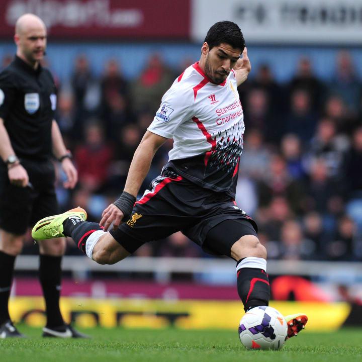 Luis Suarez shoots from a free-kick