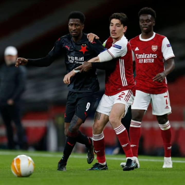 Hector Bellerin jostles for possession