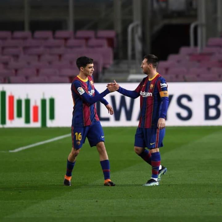 Pedri celebrates with Messi