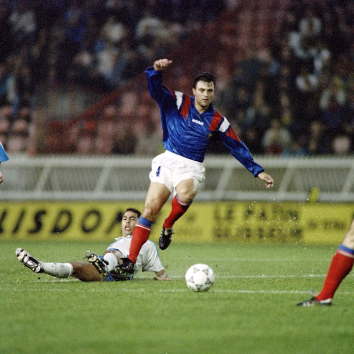 French defender Alain Roche passes an Is