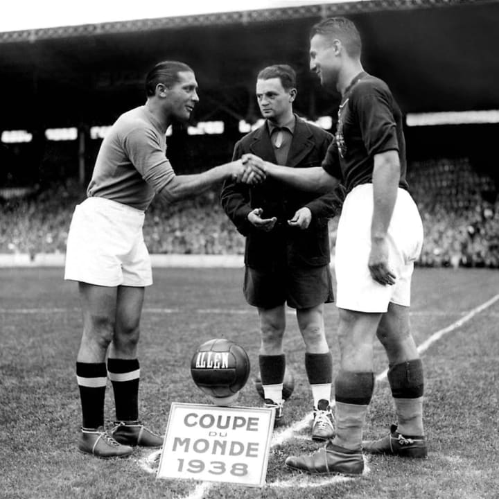 French referee Georges Capdeville (C) looks on as