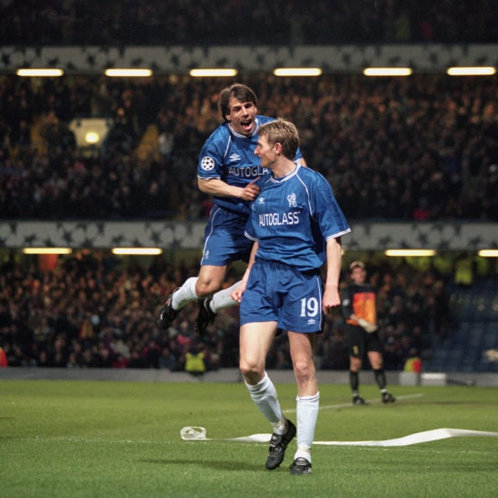 Gianfranco Zola celebrates with Tore Andre Flo after one of his goals against Barça