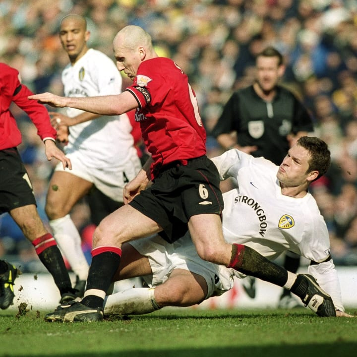 Jaap Stam and Mark Viduka
