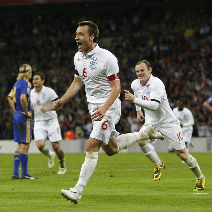 John Terry of England (C) celebrates sco